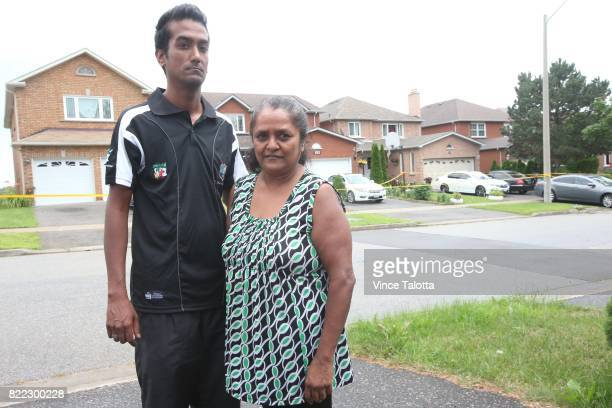TORONTO ON JULY 23 Peter and his mom Bibi Paul pose for pictures on their driveway across the street from 83 Gennela Square The scene of fatal bbq...