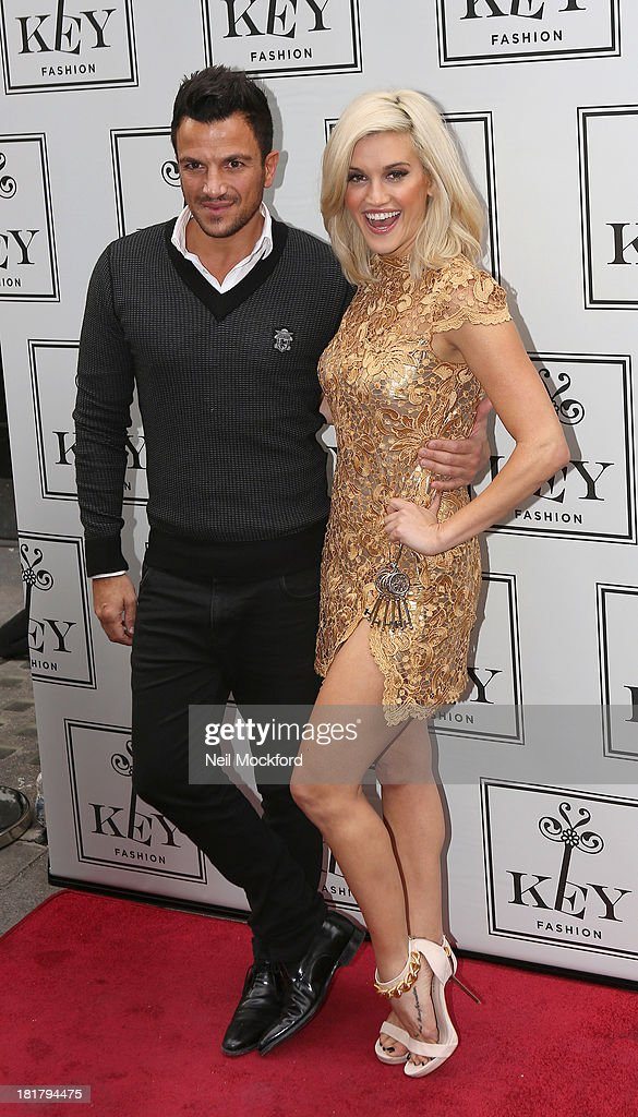Peter Andre and Ashley Roberts attends a photocall to launch the KEY Fashion brand at Vanilla on September 25, 2013 in London, England.