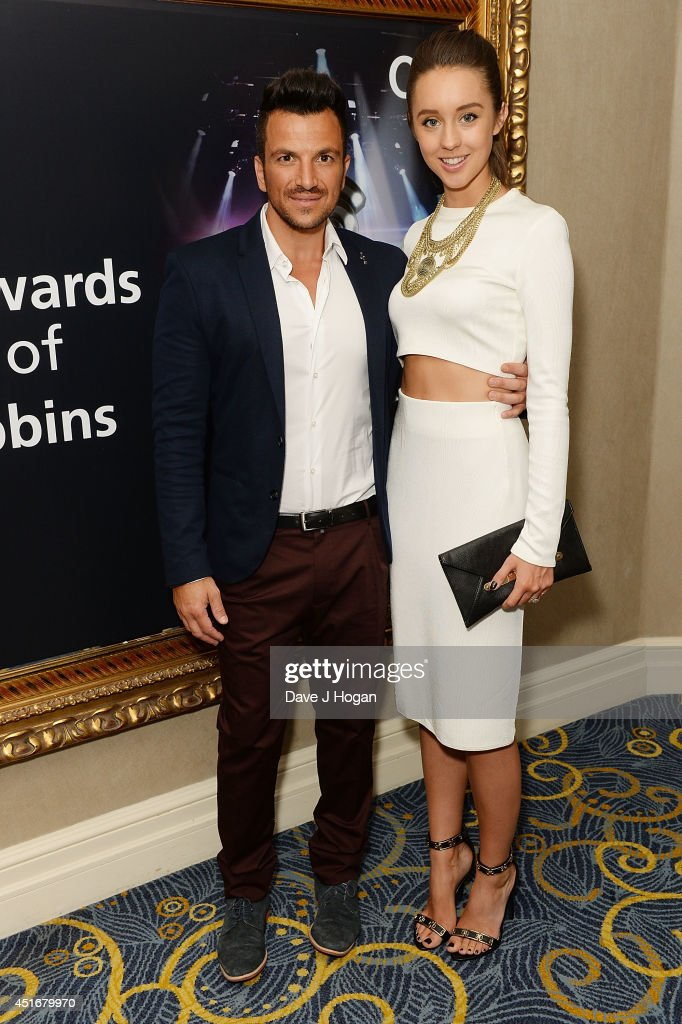<a gi-track='captionPersonalityLinkClicked' href=/galleries/search?phrase=Peter+Andre&family=editorial&specificpeople=201546 ng-click='$event.stopPropagation()'>Peter Andre</a> and <a gi-track='captionPersonalityLinkClicked' href=/galleries/search?phrase=Emily+MacDonagh&family=editorial&specificpeople=9555202 ng-click='$event.stopPropagation()'>Emily MacDonagh</a> attends the Nordoff Robbins 02 Silver Clef awards at London Hilton on July 4, 2014 in London, England.