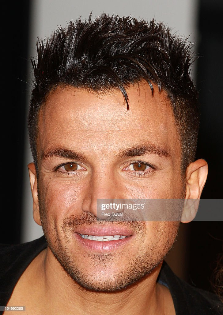<a gi-track='captionPersonalityLinkClicked' href=/galleries/search?phrase=Peter+Andre&family=editorial&specificpeople=201546 ng-click='$event.stopPropagation()'>Peter Andre</a> meets fans and signs copies of his album 'Angels & Demons' at HMV, Oxford Street on October 30, 2012 in London, England.