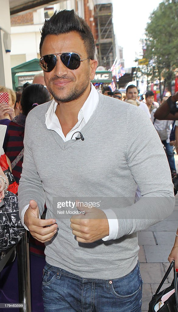 <a gi-track='captionPersonalityLinkClicked' href=/galleries/search?phrase=Peter+Andre&family=editorial&specificpeople=201546 ng-click='$event.stopPropagation()'>Peter Andre</a> meets fans and signs his perfumes 'Forever' and 'Forever Young' at The Perfume Shop on September 4, 2013 in London, England.