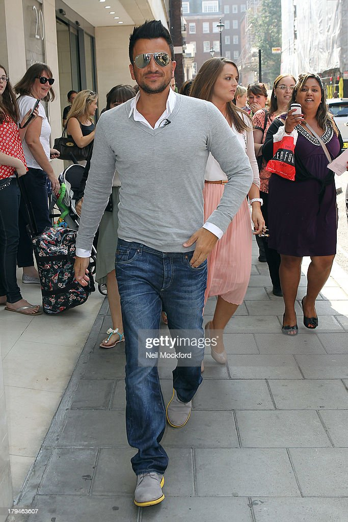Peter Andre meets fans and signs his perfumes 'Forever' and 'Forever Young' at The Perfume Shop on September 4, 2013 in London, England.