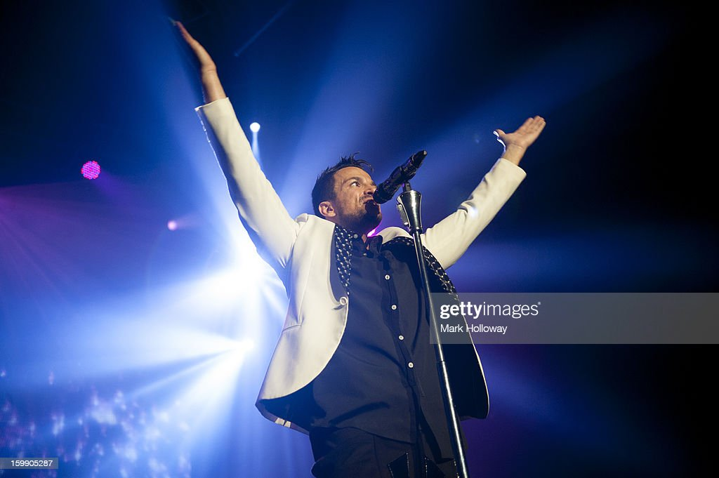 Peter Andre performs on stage in concert at BIC on January 22, 2013 in Bournemouth, England.