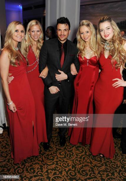 Peter Andre poses with girl group Passionata attend the TiE UK Awards 2013 at The Grosvenor House Hotel on March 18 2013 in London England