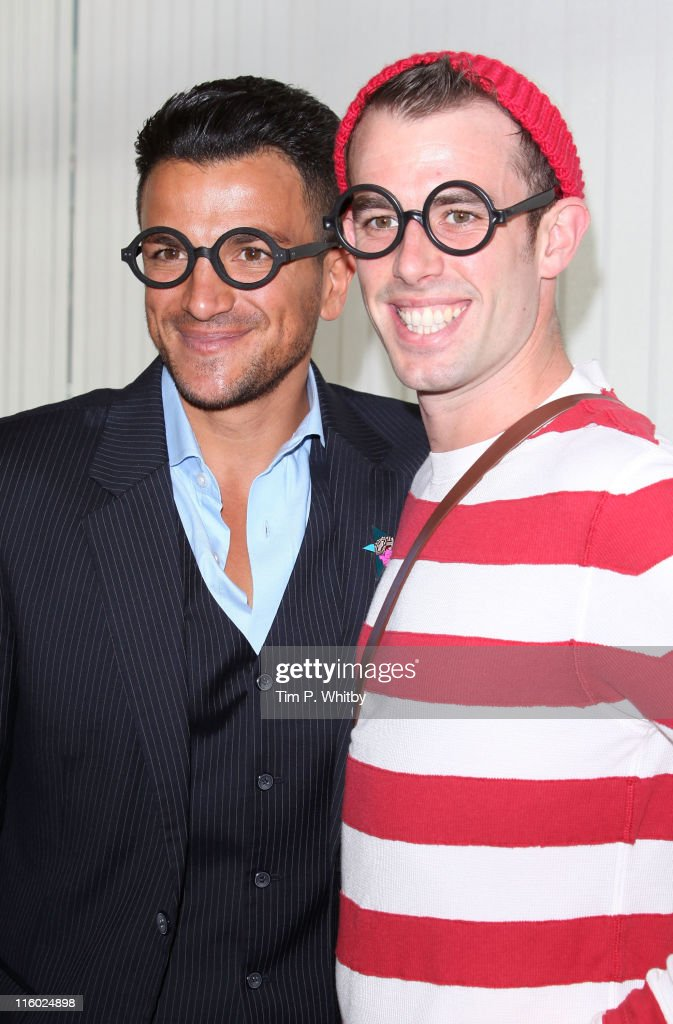 <a gi-track='captionPersonalityLinkClicked' href=/galleries/search?phrase=Peter+Andre&family=editorial&specificpeople=201546 ng-click='$event.stopPropagation()'>Peter Andre</a> with a 'Where's Wally?' impersonator, help launch a new reading and literacy project at Botwell Green Library on June 14, 2011 in London, England.