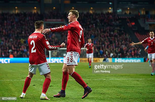 Peter Ankersen and Nicolai Jorgensen of Denmark celebrate after scoring their second goal during the FIFA 2018 World Cup Qualifier match between...