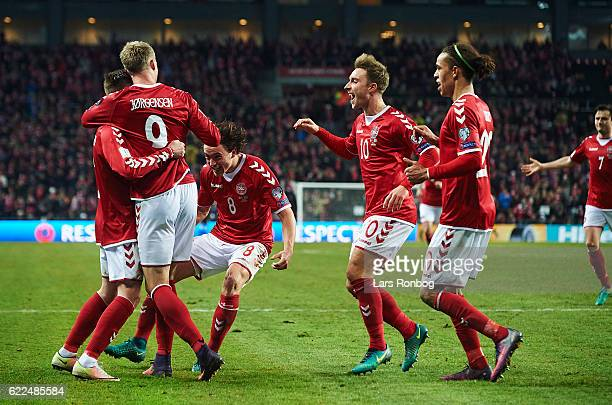Peter Ankersen Nicolai Jorgensen Thomas Delaney Thomas Delaney and Yussuf Yurary Poulsen of Denmark celebrate after scoring their third goal during...