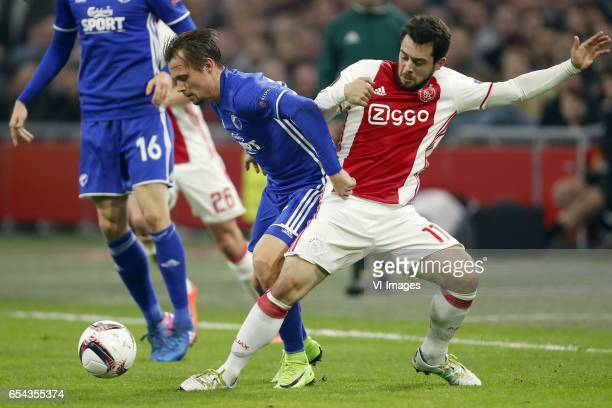 Peter Ankersen of FC Copenhagen Amin Younes of Ajaxduring the UEFA Europa League round of 32 match between Ajax Amsterdam and FC Copenhagen at the...