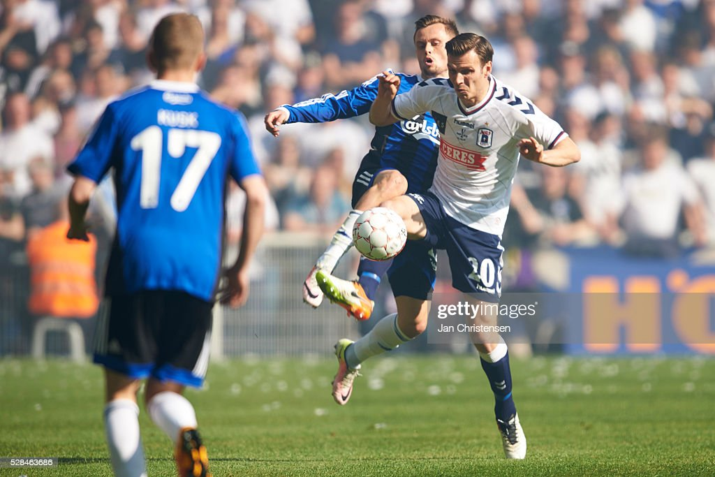 Peter Ankersen of FC Copenhagen and Elmar Bjarnason of AGF Arhus compete for the ball during the DBU Pokalen Cup Final match between AGF Arhus and FC Copenhagen at Telia Parken Stadium on May 05, 2016 in Copenhagen, Denmark.