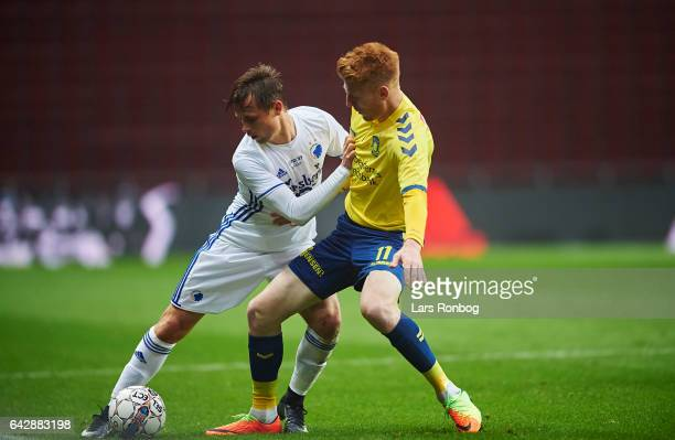 Peter Ankersen of FC Copenhagen and Zsolt Kalmar of Brondby IF compete for the ball during the Danish Alka Superliga match between FC Copenhagen and...