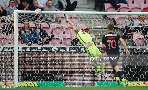 Peter Ankersen of FC Copenhagen scores the 20 goal against Goalkeeper Johan Dahlin of FC Midtjylland during the Danish Alka Superliga match between...