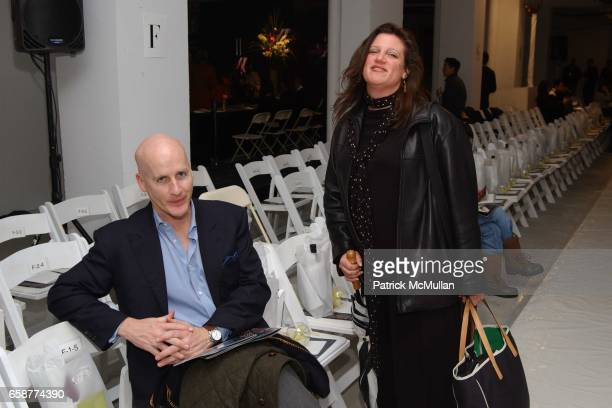 Peter Arnold and Lisa Smilor attend the DooRi Fashion Show Front Row at Mao Space on February 6 2004 in New York City