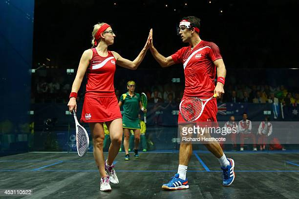 Peter Barker and Alison Waters of England celebrate a point in the Mixed Doubles Gold Medal Match against David Palmer and Rachael Grinham of...