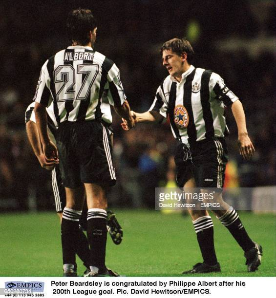 Peter Beardsley is congratulated by Philippe Albert after his 200th League goal