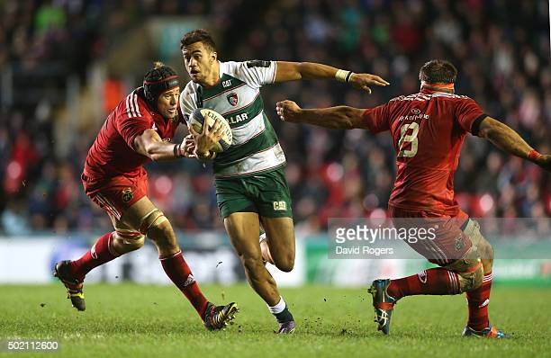 Peter Betham of Leicester breaks with the ball past Mark Chisholm and CJ Stander during the European Rugby Champions Cup match between Leicester...
