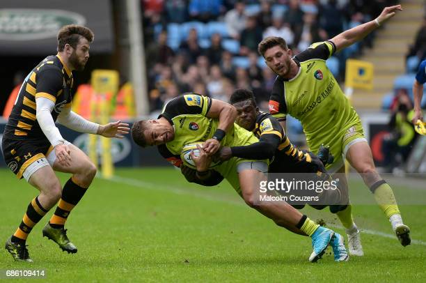 Peter Betham of Leicester Tigers is tackled by Christian Wade of Wasps during the Aviva Premiership match between Wasps and Leicester Tigers at The...