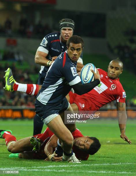 Peter Betham of the Rebels breaks through a tackle to score a try during the round 12 Super Rugby match between the Melbourne Rebels and the...