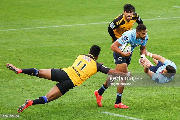 Peter Betham of the Waratahs is tackled by Julian Savea of the Hurricanes during the round 10 Super Rugby match between the Hurricanes and the...