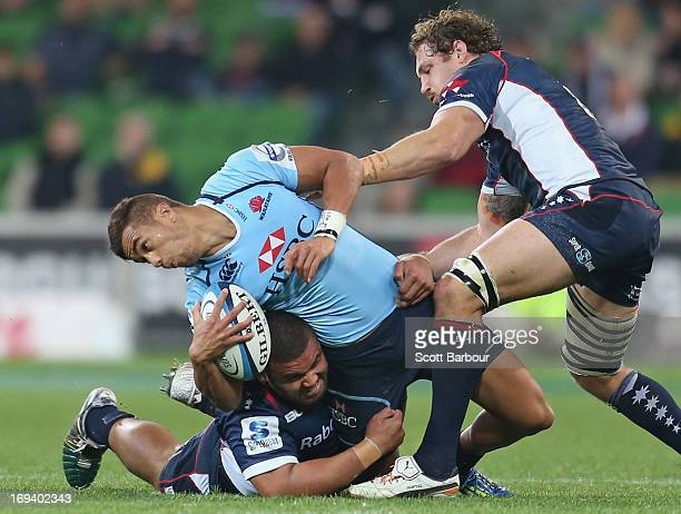 Peter Betham of the Waratahs is tackled by Scott Higginbotham of the Rebels during the round 15 Super Rugby match between the Rebels and the Waratahs...