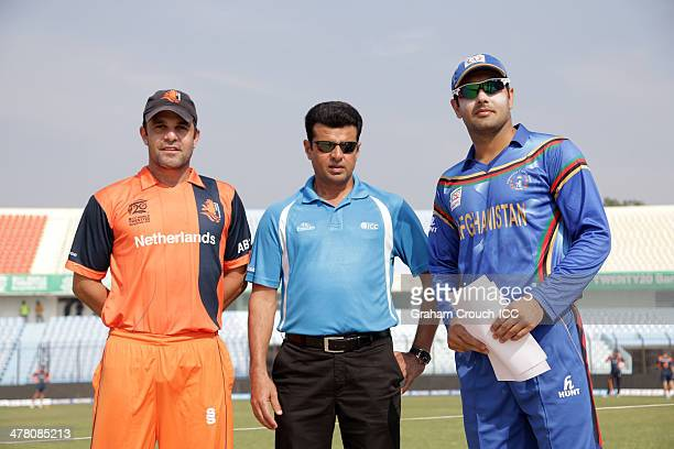 Peter Borren captain of Netherlands match referee Aleem Dar and Mohammad Nabi captain of the Afghanistan and at the coin toss ahead of the practise...