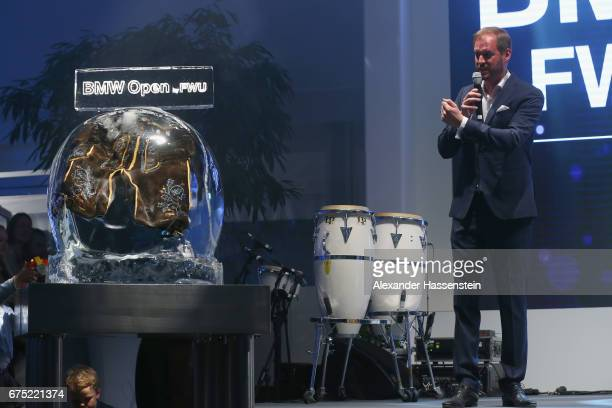 Peter Bosch presents the frozen winners Lederhosen at the Players Night of the 102 BMW Open by FWU at Iphitos tennis club on April 30 2017 in Munich...