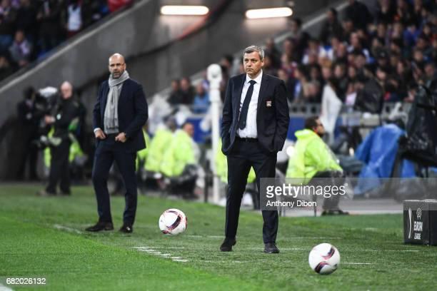 Peter Bosz coach of Ajax and Bruno Genesio coach of Lyon during the Uefa Europa League semi final second leg match between Olympique Lyonnais Lyon...
