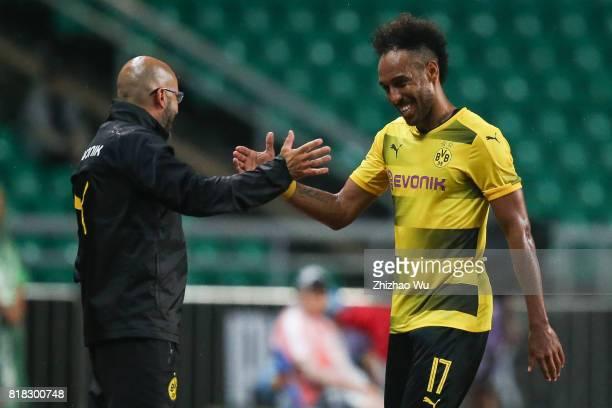 Peter Bosz coach of Borussia Dortmund and PierreEmerick Aubameyang during the 2017 International Champions Cup football match between AC Milan and...
