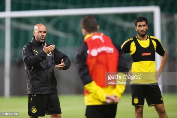 Peter Bosz coach of Borussia Dortmund talk with player duirng the training session ahead of the 2017 International Champions Cup football match...