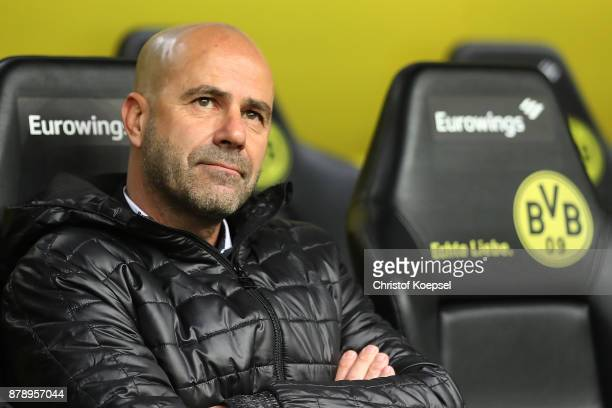 Peter Bosz coach of Dortmund sits on the bench before the Bundesliga match between Borussia Dortmund and FC Schalke 04 at Signal Iduna Park on...