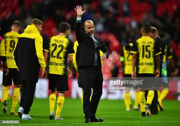 Peter Bosz head coach of Borussia Dortmund shows appreciation to the fans after the UEFA Champions League group H match between Tottenham Hotspur and...