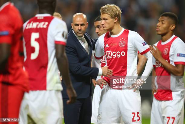 Peter Bosz manager / head coach of Ajax consoles his players after the UEFA Europa League Final match between Ajax and Manchester United at Friends...