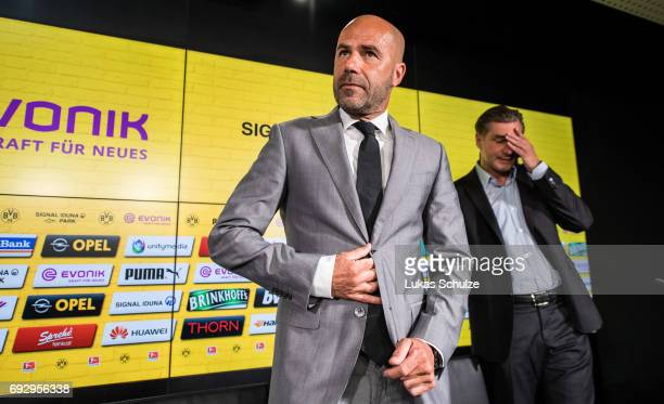 Peter Bosz the new head coach of Borussia Dortmund and Michael Zorc Director of Sports of Borussia Dortmund attend a press conference at Signal Iduna...