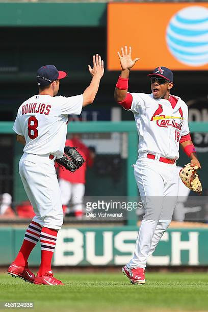 Peter Bourjos and Oscar Taveras of the St Louis Cardinals celebrate after defeating the Milwaukee Brewers 32 at Busch Stadium on August 3 2014 in St...