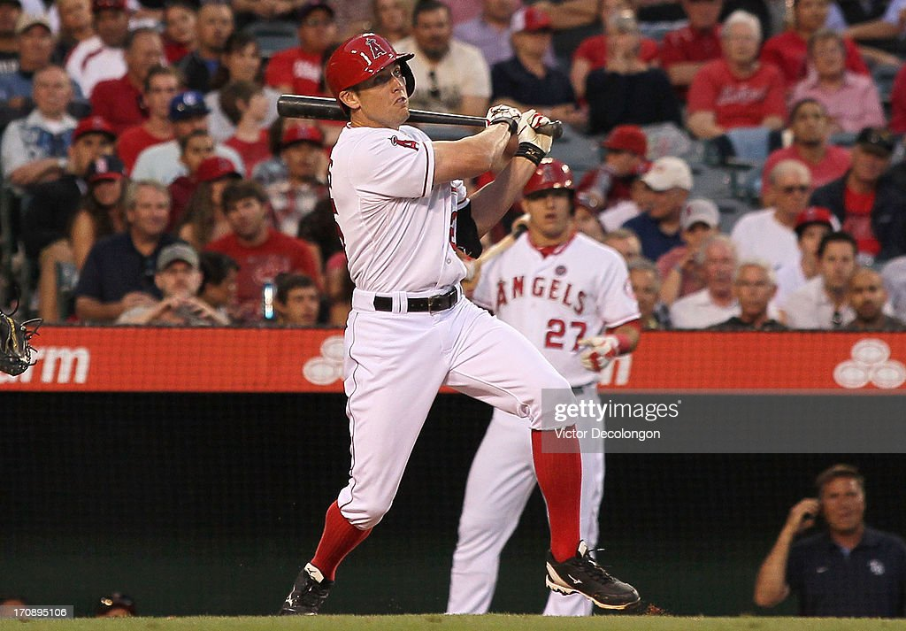 <a gi-track='captionPersonalityLinkClicked' href=/galleries/search?phrase=Peter+Bourjos&family=editorial&specificpeople=4959085 ng-click='$event.stopPropagation()'>Peter Bourjos</a> #25 of the Los Angeles Angels of Anaheim hits a double to deep right field in the third inning during the MLB game against the Seattle Mariners at Angel Stadium of Anaheim on June 19, 2013 in Anaheim, California. The Angels defeated the Mariners 1-0.