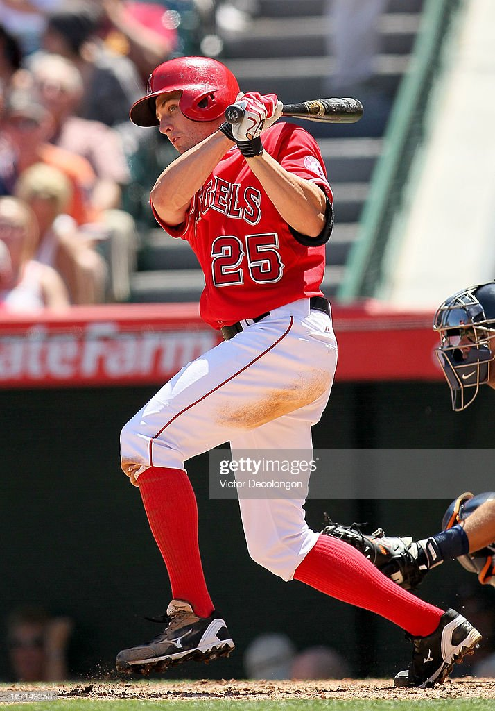 Peter Bourjos #25 of the Los Angeles Angels of Anaheim hits an infield single to shortstop in the third inning against the Detroit Tigers during the MLB game at Angel Stadium of Anaheim on April 20, 2013 in Anaheim, California. The Angels defeated the Tigers 10-0.