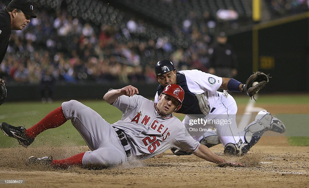 <a gi-track='captionPersonalityLinkClicked' href=/galleries/search?phrase=Peter+Bourjos&family=editorial&specificpeople=4959085 ng-click='$event.stopPropagation()'>Peter Bourjos</a> #25 of the Los Angeles Angels of Anaheim is put out by catcher <a gi-track='captionPersonalityLinkClicked' href=/galleries/search?phrase=Miguel+Olivo&family=editorial&specificpeople=209185 ng-click='$event.stopPropagation()'>Miguel Olivo</a> #30 of the Seattle Mariners while trying to score on a fielders choice by Torii Hunter at Safeco Field on September 1, 2011 in Seattle, Washington.