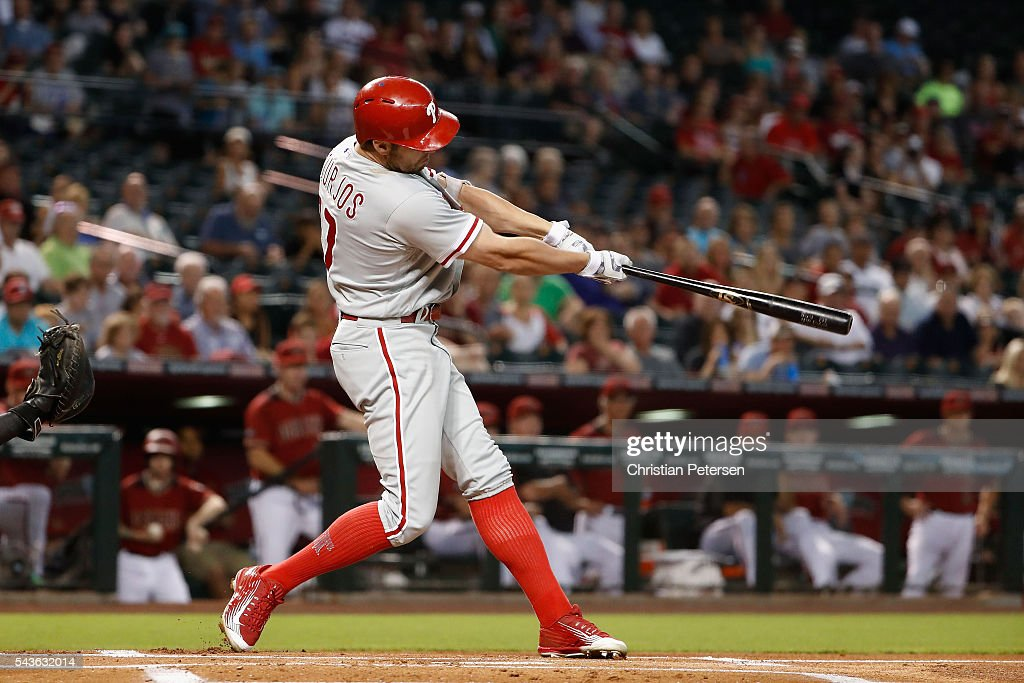 <a gi-track='captionPersonalityLinkClicked' href=/galleries/search?phrase=Peter+Bourjos&family=editorial&specificpeople=4959085 ng-click='$event.stopPropagation()'>Peter Bourjos</a> #17 of the Philadelphia Phillies hits a two-run home run against the Arizona Diamondbacks during the first inning of the MLB game at Chase Field on June 29, 2016 in Phoenix, Arizona.