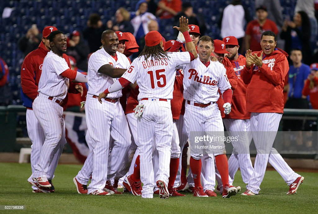 Peter Bourjos #17 of the Philadelphia Phillies is mobbed by teammates after hitting a game winning walk-off infield single in the 11th inning during a game against the New York Mets at Citizens Bank Park on April 20, 2016 in Philadelphia, Pennsylvania. The Phillies won 5-4 in 11 innings.