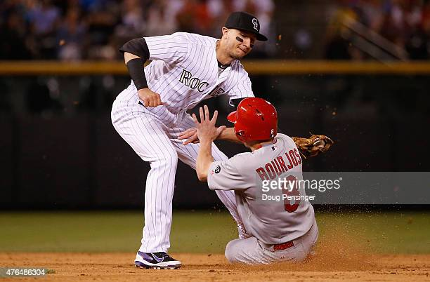 Peter Bourjos of the St Louis Cardinals is caught stealing second base as shortstop Troy Tulowitzki of the Colorado Rockies makes the tag in the...