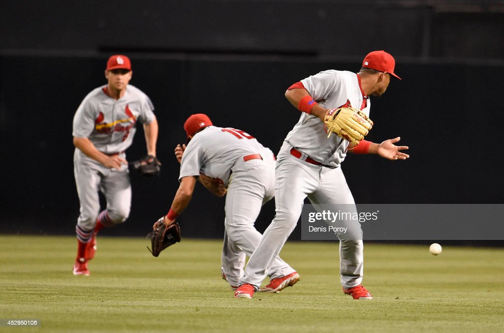 Peter Bourjos #8 of the St. Louis Cardinals, left, Kolten Wong #16 , center, and Oscar Taveras #18, right, misplay a double hit by Alexi Amarista #5 of the San Diego Padres during the third inning of a baseball game at Petco Park July 30, 2014 in San Diego, California.