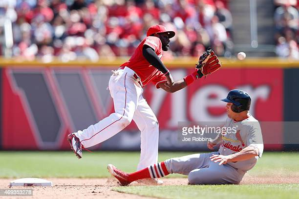 Peter Bourjos of the St Louis Cardinals steals second base in the ninth inning ahead of the throw to Brandon Phillips of the Cincinnati Reds during...