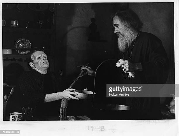 Peter Boyle asks for more food from Gene Hackman in a scene from the movie 'Young Frankenstein' circa 1974