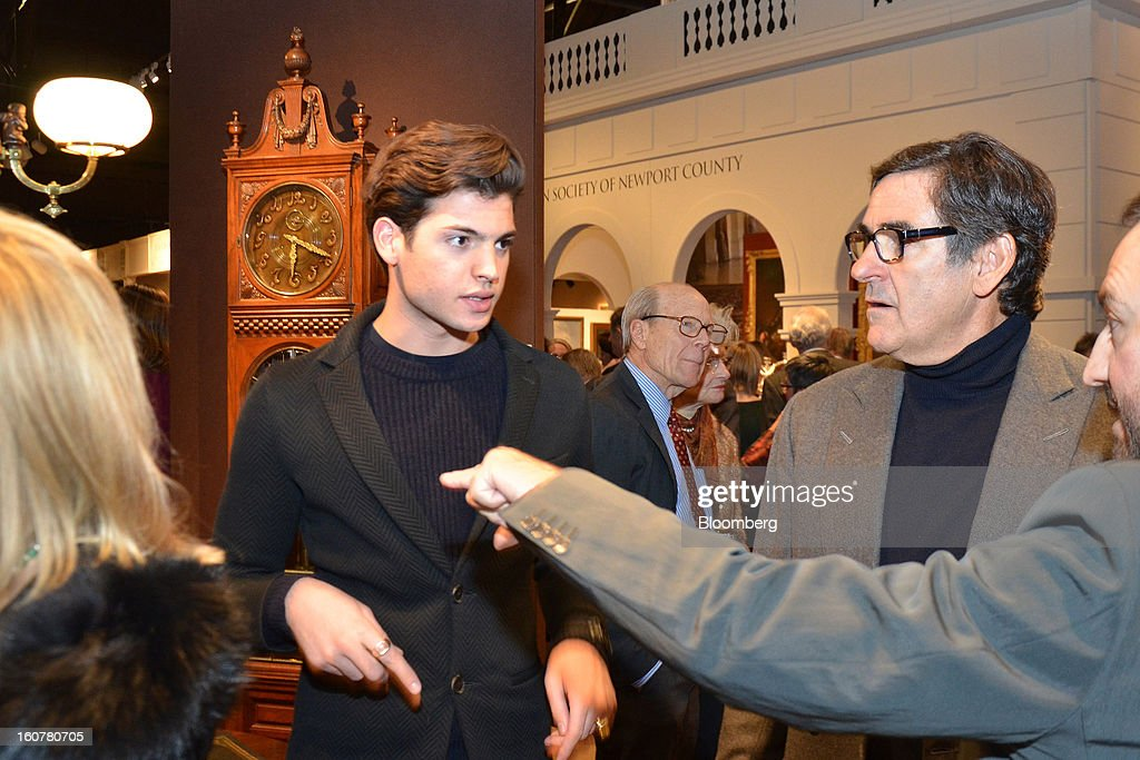 Harry Brant and his father Peter Brant, an art collector and publisher, shop together during the Winter Antiques Show gala preview at the Park Avenue Armory in New York, U.S., on Thursday, Jan. 24, 2013. The preview benefitted East Side House Settlement, which provides educational services in the South Bronx. Photographer: Amanda Gordon/Bloomberg via Getty Images
