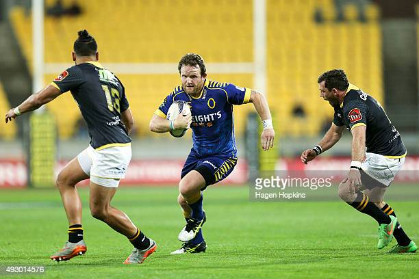 Peter Breen of Otago is runs at Matt Proctor and Jonny Bentley of Wellington during the ITM Cup Semi Final between Wellington and Otago at Westpac...