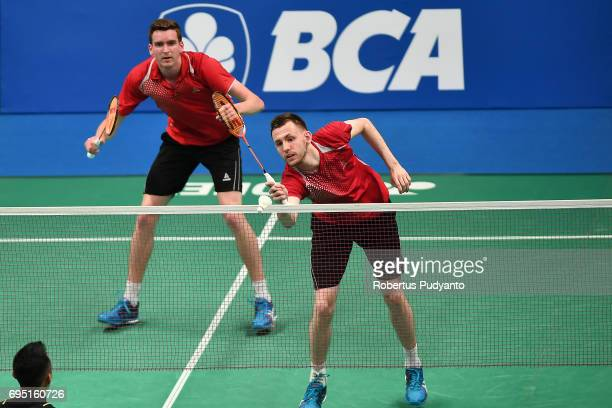 Peter Briggs and Tom Wolfenden of England compete against Lukhi Apri Nugroho and Tedi Supriadi of Indonesia during their qualification round match of...