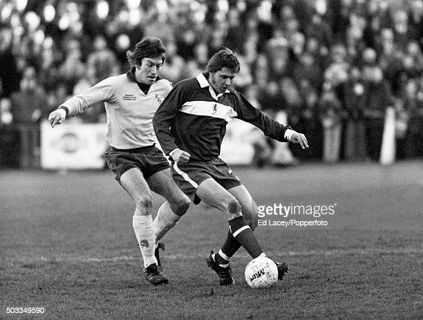 Peter Brine of Middlesbrough is challenged by M Holifield of Wycombe Wanderers during the FA Cup 3rd round match between Wycombe and Middlesbrough at...