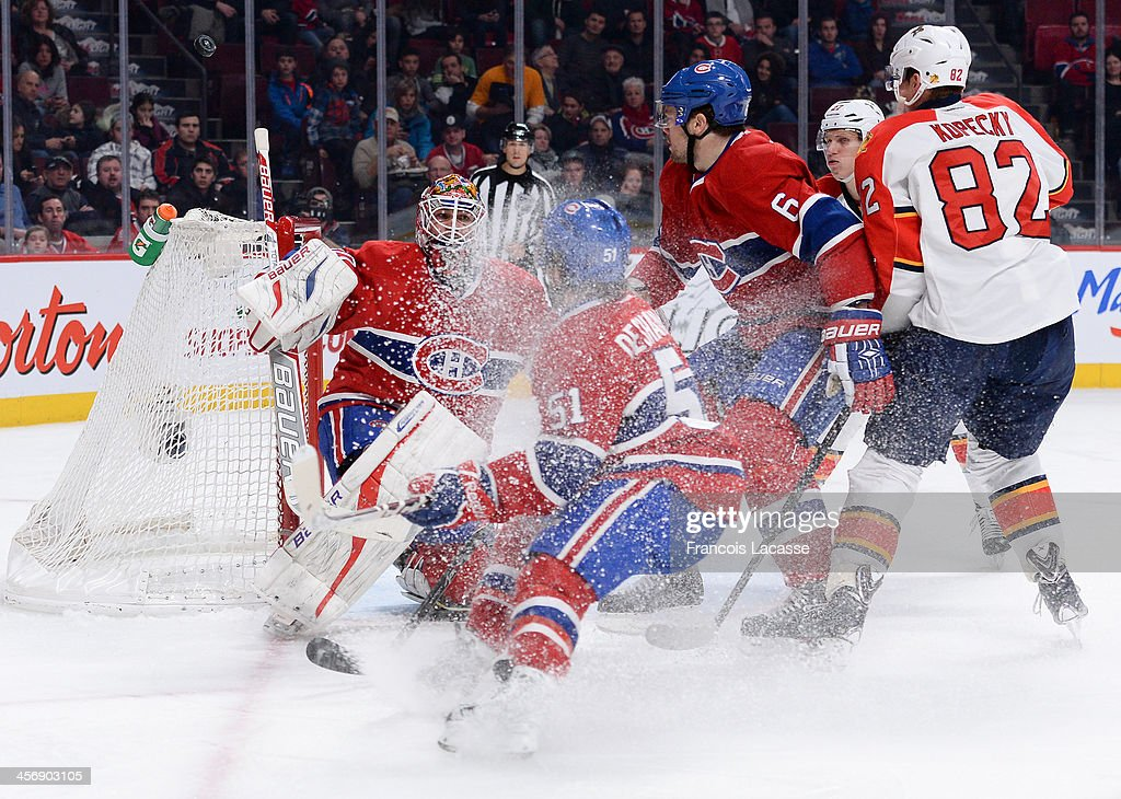 <a gi-track='captionPersonalityLinkClicked' href=/galleries/search?phrase=Peter+Budaj&family=editorial&specificpeople=228123 ng-click='$event.stopPropagation()'>Peter Budaj</a> #30, <a gi-track='captionPersonalityLinkClicked' href=/galleries/search?phrase=David+Desharnais&family=editorial&specificpeople=4084305 ng-click='$event.stopPropagation()'>David Desharnais</a> #51 and Douglas Murray #6 of the Montreal Canadiens, defend the goal against <a gi-track='captionPersonalityLinkClicked' href=/galleries/search?phrase=Tomas+Kopecky&family=editorial&specificpeople=2234349 ng-click='$event.stopPropagation()'>Tomas Kopecky</a> #82 of the Florida Panthers during the NHL game on December 15, 2013 at the Bell Centre in Montreal, Quebec, Canada.