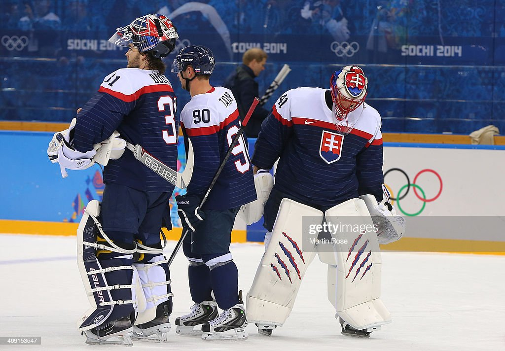 Peter Budaj #31 of Slovakia, Tomas Tatar #90 of Slovakia and Jaroslav Halak #41 of Slovakia dejected after their 7-1 loss to the United States after the Men's Ice Hockey Preliminary Round Group A game on day six of the Sochi 2014 Winter Olympics at Shayba Arena on February 13, 2014 in Sochi, Russia.