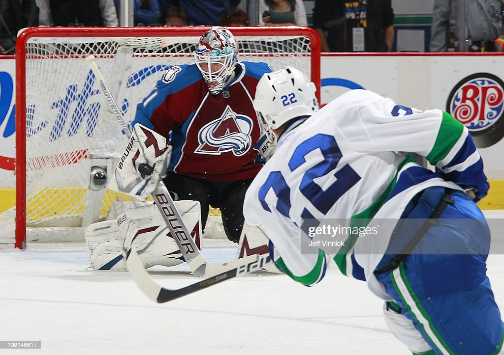 <a gi-track='captionPersonalityLinkClicked' href=/galleries/search?phrase=Peter+Budaj&family=editorial&specificpeople=228123 ng-click='$event.stopPropagation()'>Peter Budaj</a> #31 of the Colorado Avalanche makes a blocker save off the shot of <a gi-track='captionPersonalityLinkClicked' href=/galleries/search?phrase=Daniel+Sedin&family=editorial&specificpeople=202492 ng-click='$event.stopPropagation()'>Daniel Sedin</a> #22 of the Vancouver Canucks at Rogers Arena on October 26, 2010 in Vancouver, British Columbia, Canada. Vancouver won 4-3 in overtime.