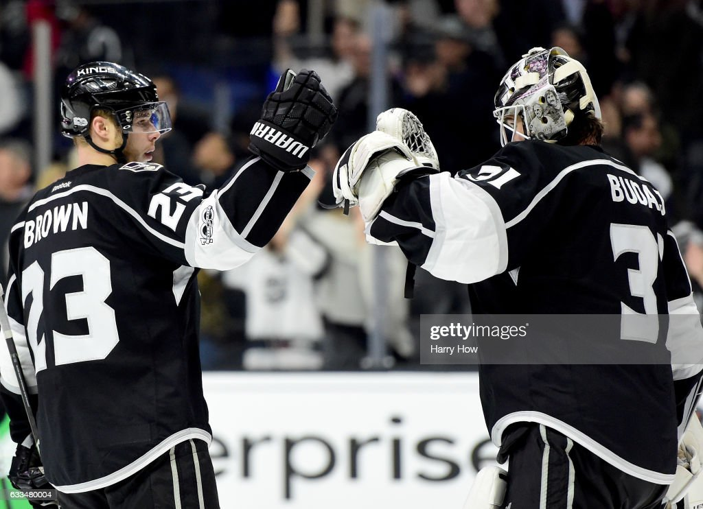 Peter Budaj #31 of the Los Angeles Kings celebrates a 5-0 shutout win over the Colorado Avalanche with Dustin Brown #23 at Staples Center on February 1, 2017 in Los Angeles, California.